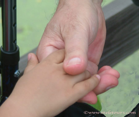 little boy's hand in man's hand