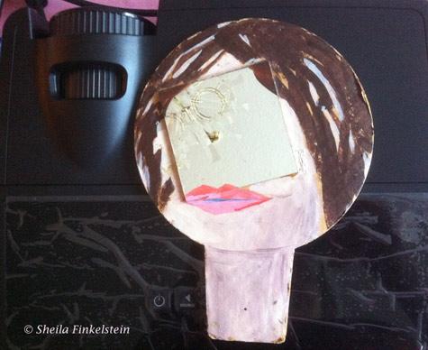 mirror in cardboard face