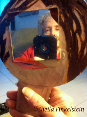Sheila Finkelstei reflection in mirror with iPhone