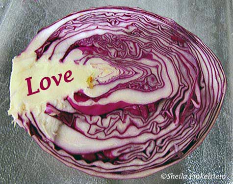 cut red cabbage expressing love